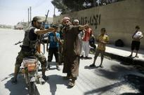 Islamic State flees former north Syria stronghold as US-backed fighters free hostages