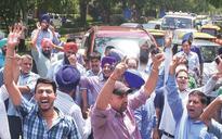 Delhi: Cab drivers' protests bring city to a still