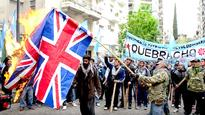 Argentines protest Falkland Islands military drills, burn Brit flags