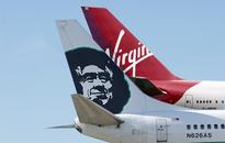 Alaska Airlines says might keep Virgin America brand