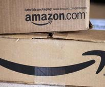 Amazon to play by India's e-commerce rules, to invest more in the country