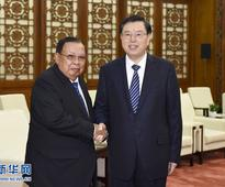 Zhang Dejiang Meets with General Secretary of the LPRP Centr...