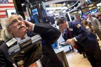 Falling energy shares weigh on global equities, oil down