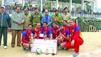 King Khan Doda lifts volleyball trophy