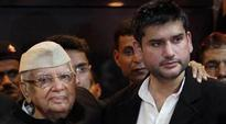 ND Tiwari, son Rohit Shekhar cross over to BJP in presence of Amit Shah