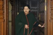 Jaya goes into a huddle with officials in her hospital room