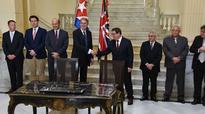 Britain's Hammond, Cuba's Castro agree on debt... Britain's Foreign Secretary Philip Hammond (4-L) shakes hands ...
