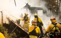 California mountain homes threatened by destructive wildfire