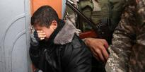 A Palestinian youth mourns the death of seven Hamas militants