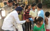 Delhi: BJP leader gives crackers to kids, leaves party red-faced