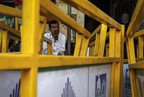Sensex stages modest recovery after plunging nearly 330 points