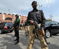 Pakistan gunfight kills three policemen, one attacker; local militants blamed for attack