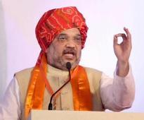 Will uproot Congress from Assam, Karnataka: Amit Shah