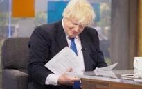 Boris Johnson sneaks a look at Robert Peston's interview questions when he isn't looking