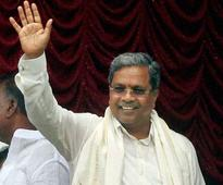 Siddaramaiah inducts 28 Ministers, largely keeps tainted away