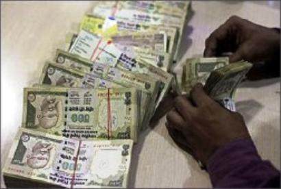 Rupee ends flat; down 1 paisa Vs dollar at 54.52