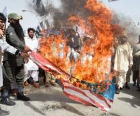 Pakistan police, kin seek murder charge over driver killed along with Taliban chief in U.S. drone strike