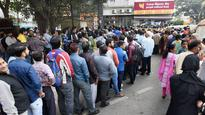 Payday rush: Reeling from currency shortage, banks resort to rationing of cash