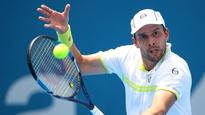 Gilles Muller through to Sydney International final after beating Victor Troicki