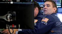 Wall Street slips from record levels on weak oil prices