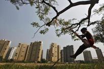 Govt warns real estate developers of action