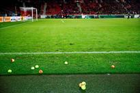 Borussia Dortmund fans interrupt cup tie by throwing tennis balls onto the pitch