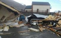 Hurricane-force winds cause wreckage and travel chaos in Wales Aberystwyth