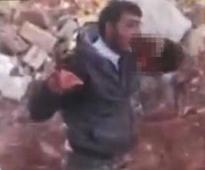 Syrian rebel shown eating soldier`s heart in a gruesome video