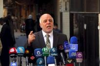 Iraq PM urges end to protests while army busy fighting Islamic State