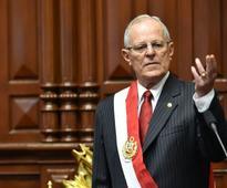 Ex-banker Kuczynski sworn in as Peruvian president