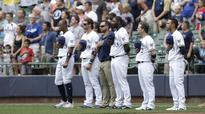 Watch: Reds Iribarren, Brewers Pina compete in national anthem standoff