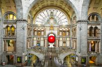 redball project squeezes into architectural landmarks across antwerp