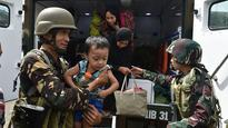 Philippines says Islamist militants took hostages in retreat from school