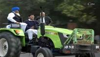 Winter Session: MP Dushyant Chautala rides tractor to Parliament