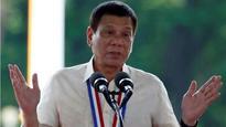 Philippine President Rodrigo Duterte adopts 'Hunger Games' salute to resist drug wars