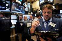 US STOCKS-Wall St lower after Fed leaves rates unchanged