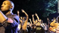 Charlotte girl weeps over police shootings