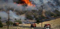California wildfire: Two dead as fire roars through dry bush