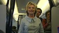 Hillary Clinton flies with traveling press corps for the first time
