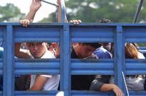 El Salvador says a brutal gang laundered money through motels, brothels, taxis