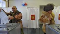 Putin eyes huge win as Russia goes to the polls