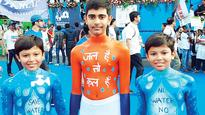 Father, twin sons run marathon with social theme every year