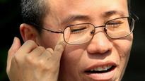 China says Nobel laureate Liu Xiaobo cremated and his wife is 'free' from house arrest