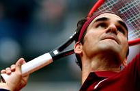 Federer tests back injury with Rome win over Zverev