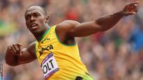 Bolt narrowly wins first 100m of 2013