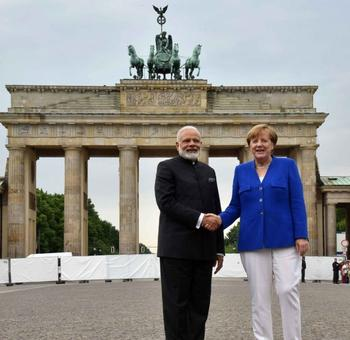 PM poses with Merkel at Brandenburg Gate before leaving Berlin