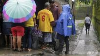 Hurricane, quake hit Central America at same time