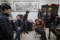 Unpaid and angry, some Chinese workers ditch holidays to protest