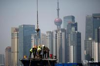 Solid growth seen for China's manufacturers in March as construction booms