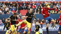 Gameiro, Godin fire Atletico to first league win in a month vs. Osasuna